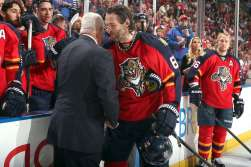 General Manager Dale Tallon congratulates Jagr on becoming the NHL's third all-time leading scorer