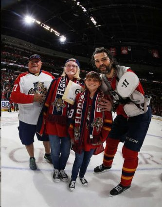 Names of the family omitted for their privacy but the family poses with Jagr after the jersey presentation.